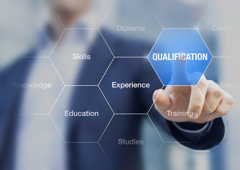 Person touching button qualification, concept about professional certification